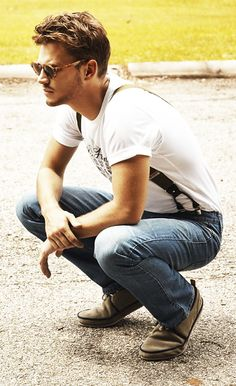 Denim with white tee and suspenders, cool casual style for men.