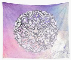 Whimsical beautiful mandala on a watercolor pink and blue design.