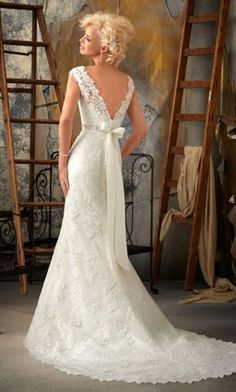 lace wedding dress…love the V-back!