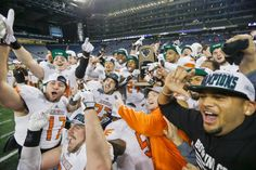 The Bowling Green team celebrates its 47-27 victory over previously unbeaten Northern Illinois at Ford Field in Detroit. (Carlos Osorio/AP)