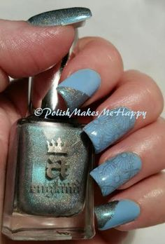 """Making another manicure last a few extra days... A simple way to freshen my manicures up! The Parrot Polish is still on, and I'm love that Twitter Blue... as an accent I used the new A England """"Captive Goddess"""" from the Rossetti's Goddess collection. Talk about a beautiful holo polish! Wow..."""