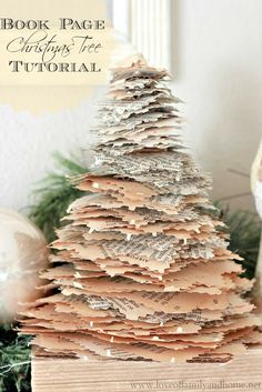 Doing this one!  Book Page Christmas Trees {Tutorial} - Love of Family & Home