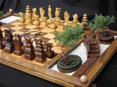 A very creative hand made chess set on etsy. I like the chess board design. most chess set designers don't put enough effort into a board.