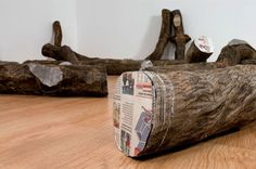 Columbian artist Miler Lagos: TREE TRUNKS MADE FROM STACKED NEWSPAPERS