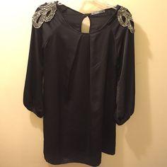 Short Black Dress Short black dress with sequin design on the shoulders. Loose fit. Mid-thigh length. Dresses