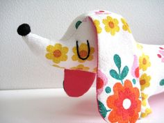 This is from my range of Mini Dachshund toys.    Handmade from original vintage cotton fabric with contrasting ear backings and base.    Nose is handmade from felt and the eyes have been chain stitched on by hand. Stuffed with polyester filling.    Measurements (approx):  12x 4 (30cm x 10cm)    Thank you for looking. Please look at my shop for more soft toys.