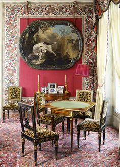 Room of the Day: love the pink walls with border, art and those animal print chairs - an original room in Paris Pied-a-Terre of Beatriz Patino  (painting by Charles Oudry) 6.19.2013. Needlepoint style carpet
