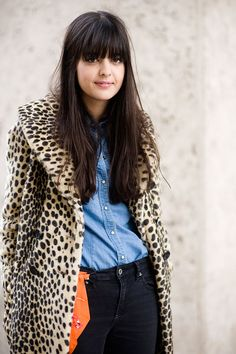 Light denim shirt paired with dark denim pants.  Nicely offset with an orange bag and a fantastic vintage leopard coat. Always good.