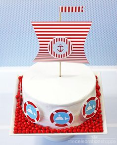 DIY nautical baby shower or birthday party cake ~ printable cake decorations ~ complete tutorial at http://www.thecelebrationshoppe.com/themes/view/little-sailor