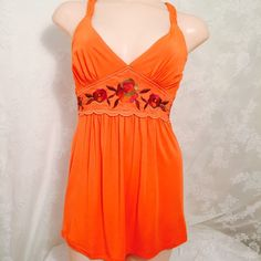 Embroidered orange racer back. Embroidered orange racer back. 90% Rayon 10% Spandex. Beautiful embroidery detail in front with other colors. Super sexy and stylish. High quality. Braided straps. Dating Clothing  Tops Camisoles