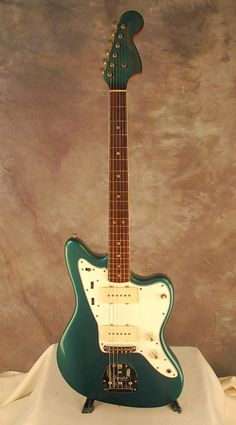 DESCRIPTION Up for sale is a fantastic player's grade custom color pre-CBS 1963 Fender Jazzmaster in a (body only) refinish, professionally done by Eric Daw. When we received this guitar the body w. Gibson Guitars, Fender Guitars, Guitar Amp, Cool Guitar, Electric 6, Fender Electric Guitar, Sounds Great, Vintage Guitars, Playing Guitar