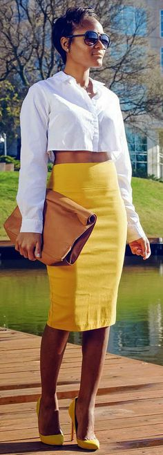 Yellow pencil skirt with white crop top and yellow pumps. I would would wear it with a white blouse but it's still a classy look.