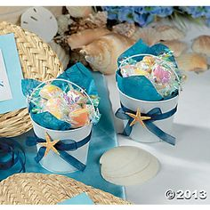 DIY: Beach Candy Buckets Project  Create these fun Beach Candy Buckets. Fun for a beach wedding or shower, these Beach Bucket favors are a sweet way to get all your guests feeling the sand between their toes