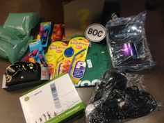 Woot! BOC - Zande ki Graddakh.  2 Apr. 2014: 2 green bags of texas air, 2 snappy straws, 1 BOC sticker, 1 purple bluetooth speaker, 1 massager, 2 M woot shirts, Ray Ban sunglasses, 2 sets of magnet clips, 1 Kodak camera case, 1 set of mens slippers size 9, 1 emergency whistle, and one ? bag