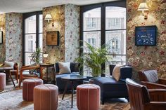 Boutique hotel group The Hoxton has debuted its fourth property, with the new opening inside an century Paris townhouse once home to Louis XV's main courtiers. The Hoxton, Paris . Paris Hotels, Hotel Boheme, Old Fireplace, Red Walls, Beautiful Hotels, Beautiful Interiors, Most Beautiful, Dream Wedding, Vertical Gardens