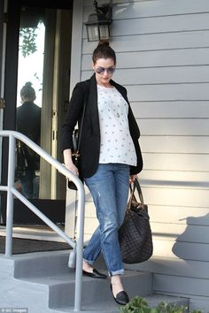 On the go: The actress did not appear to be joined by anyone as she ran errands around tow...