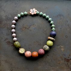 Lorelei Eurto Jewelry Chunky Vintage lucite beads Polymer beads- Orly Fuchs Galchen or Hollowology Ceramic wheel- Gaea Ceramic Peace Sign Coin- Gaea Cannaday Lampwork flower button- Susan Sheehan Seed beads, copper seed beads