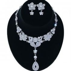Another vintage look - fabulous!  http://www.fashionjewelry21.com/necklaces/rhinestone-necklaces/86640-jmm-rhinestone-y-drop-necklace-earring-set-silver-clear.html