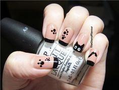 Black kitty with paw print nails - DIY nail art designs