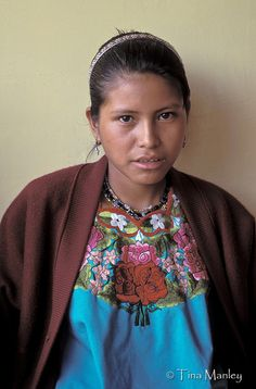 GUATEMALA, ACAL:  Young Mam girl in traditional dress and Western sweater waits to be seen at a medical clinic in the highlands of Guatemala.