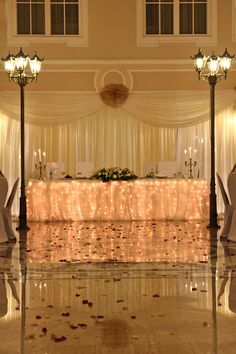 Sparkling lights. Those simple decorations can make interesting effect. Marble floor doubles the light due to reflection.