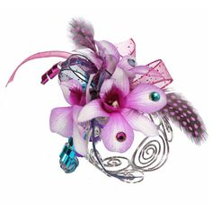 """""""Marha,"""" a favorite funky prom corsage with orchids, polka dot feathers, and lots of sparkle, shown on a curled wire bracelet. #VivianoFlowerShop #homecoming"""