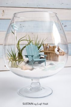 Any coastal-loving fairy needs a beachy mini garden to call home! We're sharing a full tutorial on how to make your own unique DIY air plant terrarium. #howtomakeagarden