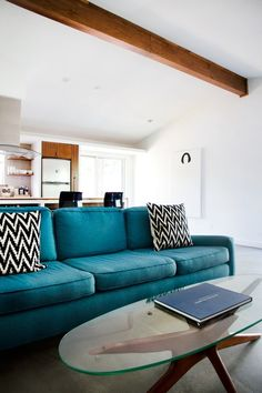 Dying for that couch. Love the color.   5 Really Great Reasons to Float The Furniture in Your Living Room