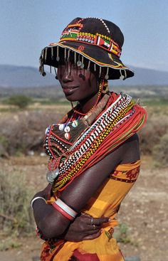 Africa | Samburu woman.  I am loving the hat!  Very unusual to see.