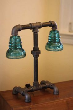 Here are more than 30 brilliant and creative ideas for using Vintage Glass Insulators in awesome DIY projects for your indoor and outdoor living areas!