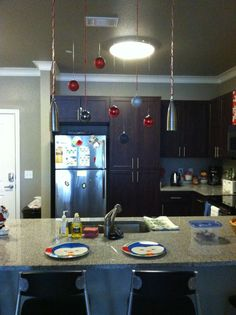 Easy Christmas DIY home/appartment. Ornaments hung from the ceiling using thumb tacks.