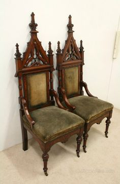 pair of carved walnut gothic chairs