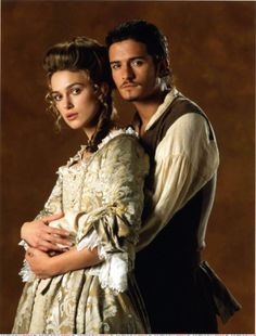 Keira Knightley as Elizabeth Swann and Orlando Bloom as William Turner in Pirates of the Caribbean: The Curse of the Black Pearl (2003).