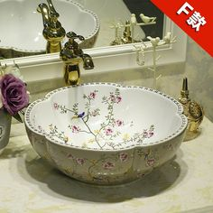 https://de.aliexpress.com/item/Ceramic-Counter-Top-Wash-Basin-Cloakroom-Hand-Painted-Vessel-Sink-bathroom-sinks-Flowers-and-birds-pattern/32798496764.html?traffic_analysisId=recommend_3035_null_null_null