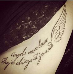 Back tattoo with wings on both sides
