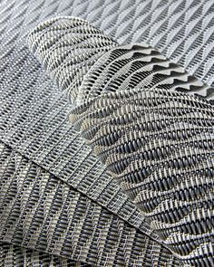 Nami vinyl-coated polyester in silver by Kova Textiles. 212-254-7591; kovatextiles.com