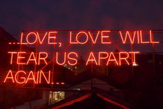 "One of 12 signs, part of Victoria Lucas' and Richard William Wheater's Months of Neon Love"" project featuring lyrics from artists such as Amy Winehouse, REM, and Joy Division (pictured. Richard Williams, Joy Division, Love Letras, Jace Lightwood, Hopeless Fountain Kingdom, Neon Licht, Neon Quotes, Music Quotes, Lit Quotes"