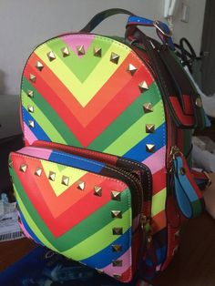 Find More Backpacks Information about Exclusive models fashion shoulder bag  backpack shoulder bag women rivet rainbow bags B010,High Quality bag  only,China ... acd897d995