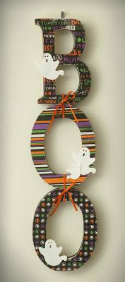 scrapbooking paper and wooden letters. Would love to put something together for my craft room with this idea