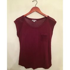 Maroon Top  HP 1/28 This is an extremely comfortable, stretchy top with mesh sleeves and back, with a pocket on the left. Gently worn. Pleione Tops