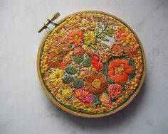 "I found this hoop on the ""embroidery"" group on flickr, by ""dozydotes"" and it is incredible. I am in love with the colors, the various stitches, everything."