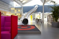 The Lego Office in Denmark designed by Rosan Bosch. I would find every reason to go down that slide at least 20 times a day.