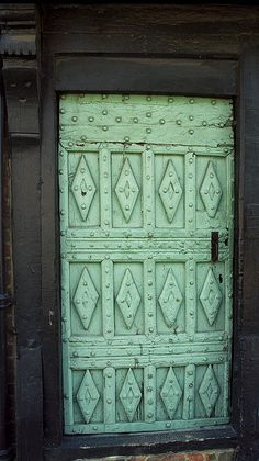 Carved green door.....