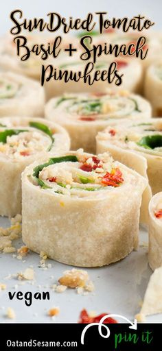 These Sun-Dried Tomato, Basil & Spinach Pinwheels make a perfect party appetizer or light lunch. They take about 15 minutes to make and are a healthy alternative to pinwheels made with cream cheese.   APPETIZERS  LUNCH   VEGETARIAN   VEGAN   ROLL UPS   PINWHEELS   Recipe at OatandSesame.com