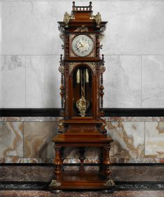 German Renaissance Revival tall case clock, c. 1870. Photo by John Faier, © The Richard H. Driehaus Museum.