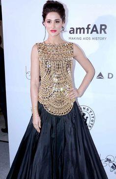 nargis fakhri gold black gown amfar
