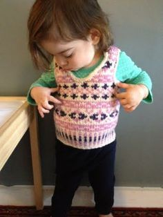 """Anne's granddaughter modeling her """"Onslow's Vest,"""" knit with Cascade Eco+."""