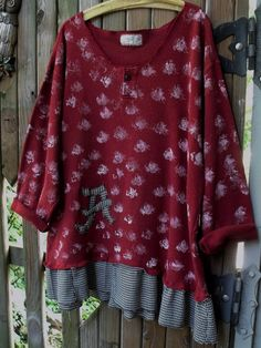 Deep Red cotton mans shirt refashioned into this fab game day tunic. Has black and white houndstooth check skirt border, long roll up sleeves, appliqued