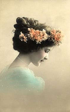 Lovely portrait, spectacular hairstyle laden with blossoms.