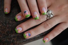 Flower Garden Nail Art.  I feel like I would want to do this with the green at the base of the nail, and use green glitter for the grass.  Green glitter over a light blue paint (to resemble the sky).